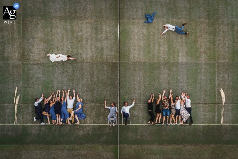 View thiscreative Toulouse wedding drone picture of the Bridesmaids, best men, bride and groom, which was a featured pictureamong the best wedding photography in France from the WPJA