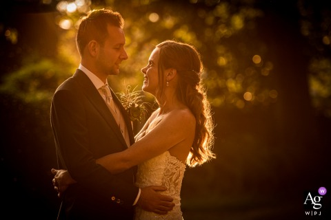 View thisgraceful Hoeven wedding image showing the couple is posing in the nice evening light, Just before sundown, which was a featured pictureamong the best wedding photography at Bovendonk from the WPJA