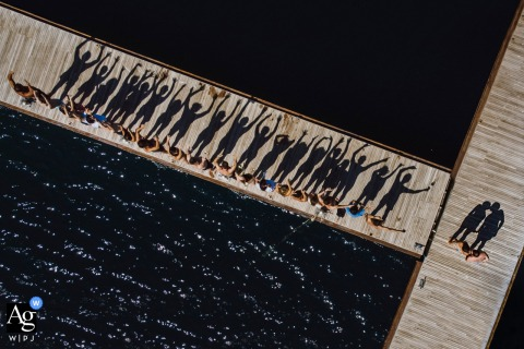 View thiscreative Bodrum Villamaçakızı Hotel wedding image during a group portrait, drone shot, with meaningful shadows, which was a featured pictureamong the best wedding photography in Turkey from the WPJA
