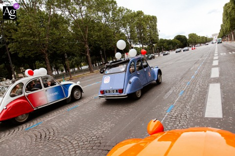 View thispictorial Italy image of wedding cars driving on the Champs-Elysees in Paris, which was a featured pictureamong the best wedding photography from the WPJA