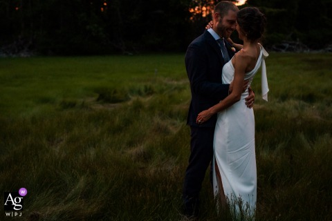 View thissensitive Dockside Guest Quarters wedding portrait of The couple taking in the last of the light which was a featured pictureamong the best wedding photography in York, Maine from the WPJA