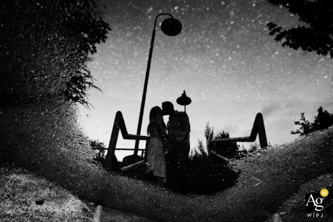Seattle Creative Wedding Photographer | Image contains: black and white, night, stars, streetlight, bride, groom, kissing