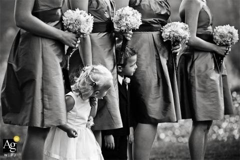 Seattle Creative Wedding Photographer | Image contains: black and white, bridesmaids, bouquet, dress, child, flower girl, ring bearer