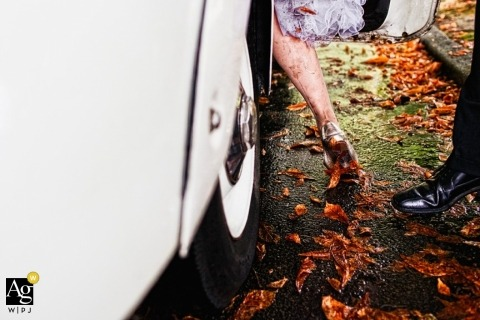 Seattle Artistic Wedding Photography | Image contains: bride, groom, detail shot, leaves, shoe, mud, classic car