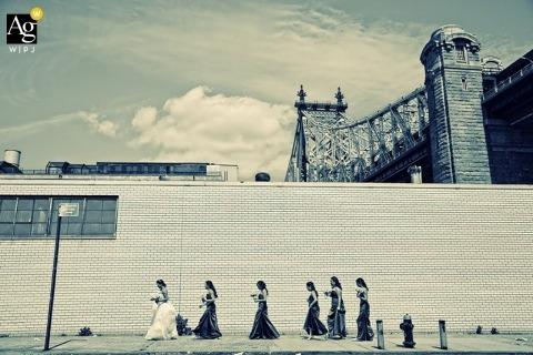 Seattle Fine Art Wedding Photography | Image contains: bride, bridesmaids, wall, city street, portrait, bridge, sky