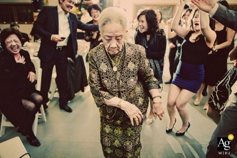 Seattle Documentary Creative Wedding Photography | Image contains: dancing, wedding reception, wedding guests, dancing, laughter, groom