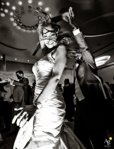 Creative Wedding Photojournalist in Ireland | Image contains: black and white, dancing, bride, groom, wedding reception, party, wedding dress