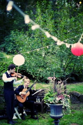 Seattle Documentary Artistic Wedding Photographer | Image contains: band, wedding reception, outdoors, guitar, fiddle, banner, balloon, flowers