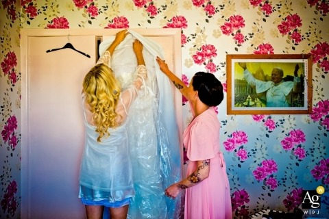 Ireland Documentary and Creative Wedding Photography | Image contains:bride, getting ready, bridesmaids, wedding dress, wall paper