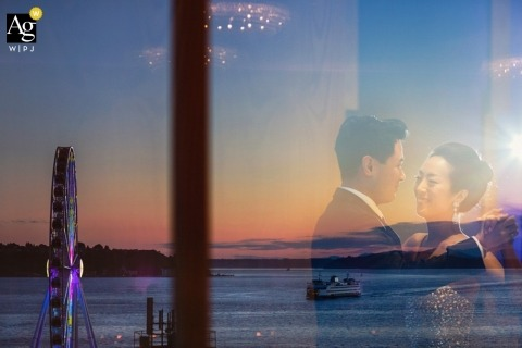 Seattle Artistic Wedding Photography | Image contains: bride, groom, portrait, windows, reflection, outdoors, water, ferris wheel, boat, ocean