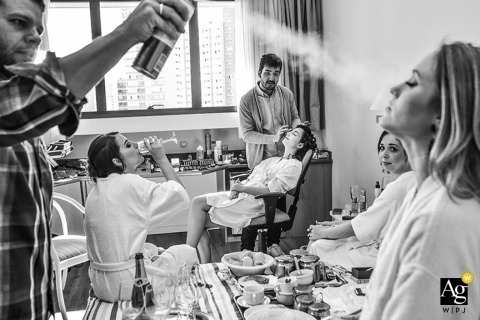 São Paulo Wedding Photojournalism | Image contains: black and white, bride, getting ready, bridesmaid, hairspray, black and white, robes