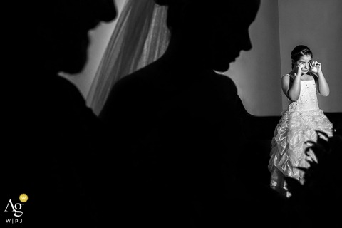 São Paulo Documentary Wedding Photography | Image contains: silhouettes, black and white, bride, emotional, wedding reception, wedding dress