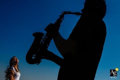 São Paulo Wedding Photographer | Image contains: silhouette, musician, saxophone, blue sky, dancing, bride