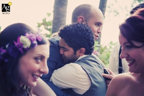 Seattle Creative Wedding Photojournalist| Image contains: bride, groom, hugs, ceremony, flower crown, outdoors