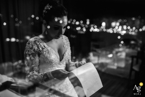 São Paulo Creative Wedding Photographer | Image contains: bride, black and white, window, reflection, lights, wedding dress, wedding reception