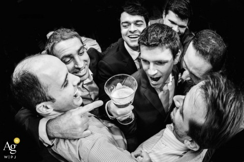 São Paulo Wedding Photography | Image contains: groom, groomsmen, drinks, wedding reception, black and white, party