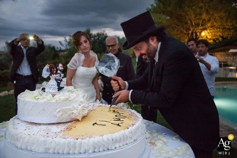 Ancona Wedding Photojournalism | Image contains: bride, groom, cake, outdoors, tophat