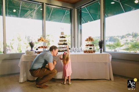 Seattle Creative Wedding Photographer | Image contains: cake, wedding reception, detail shot, child, wedding guest