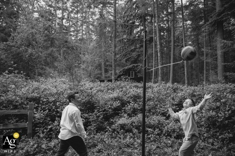 Seattle Documentary Artistic Wedding Photographer | Image contains: black and white, kids being kids, woods, wedding reception