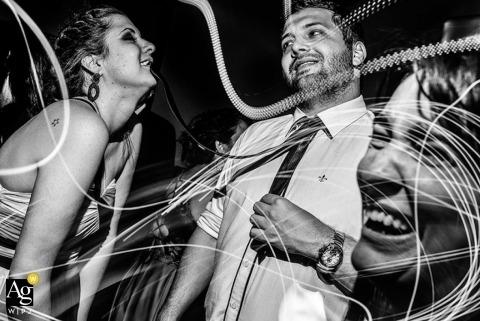São Paulo Documentary Wedding Photographer | Image contains: black and white, wedding guests, lights, bride, groom