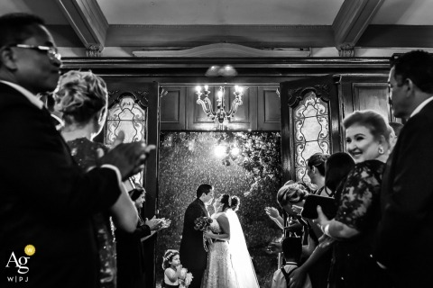 São Paulo Wedding Photography | Image contains: black and white, bride, groom, ceremony, wedding guests, kiss, flowers, bouquet
