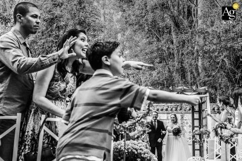 São Paulo Documentary Wedding Photographer | Image contains: black and white, ceremony, bride, groom, outdoors, wedding guest