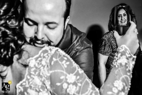 São Paulo Wedding Photographer | Image contains: black and white, bride, parents of the bride, drinks, hugs