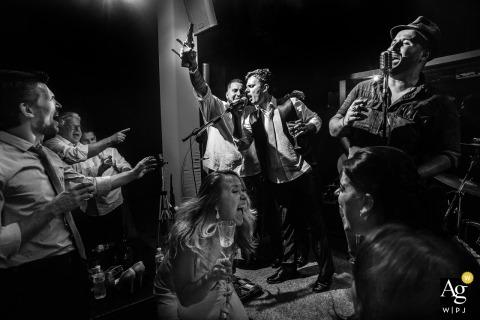 São Paulo Wedding Photojournalism | Image contains: black and white, reception, groom, toast, party, portrait