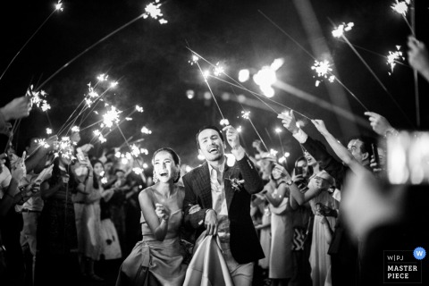 London bride and groom light sparklers after the ceremony - England wedding reportage photo