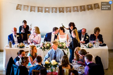 Hertfordshire bride and groom kiss at the reception - England wedding reportage photo