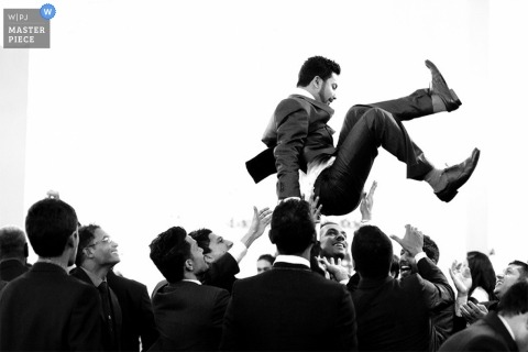 Sri Lanka groom gets thrown into the air by guests at the reception - Asia wedding photo