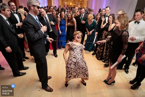 Chicago guests play limbo at the reception | Illinois wedding photo