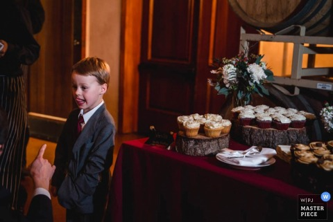 San Fransisco boy trying to get a cupcake at the reception | California wedding photography