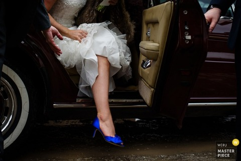 Burlington bride getting out of car while in her dress - Vermont wedding photojournalism