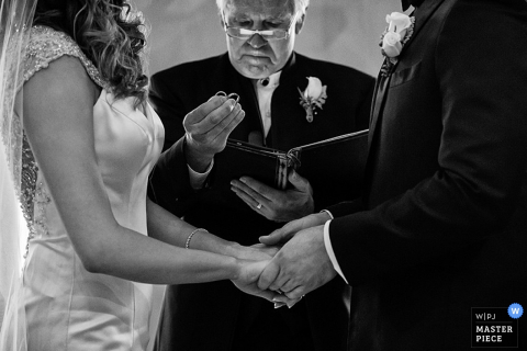 Carson City bride and groom hold hands during the ring ceremony - Nevada wedding photography