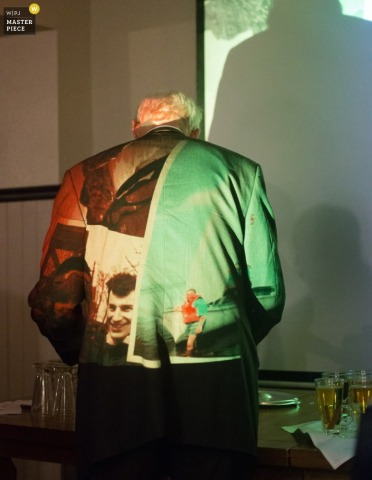 Ottawa guest wears a jacket with slideshow pictures projecting onto it at the reception - Ontario wedding photography