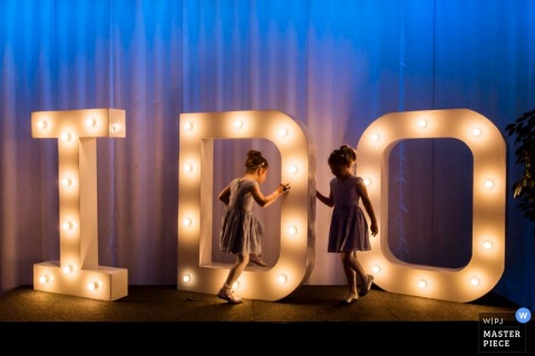 "Rotterdam kids playing together at the wedding around a large ""I do"" sign - Zuid holland wedding photography"