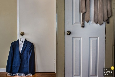 Tux and ties hanging on the door at Key West wedding | Florida wedding photojournalism