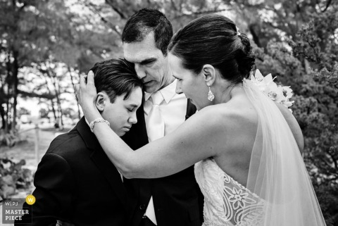 Key West bride and groom hug son at wedding | Florida wedding photo