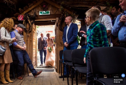 Overijssel bride and her father enter the wedding ceremony - Netherlands wedding photo