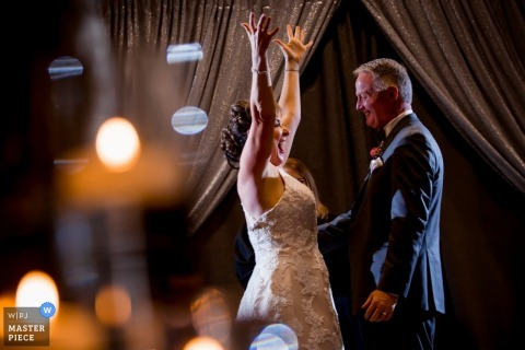 Chicago bride dances with her father at the reception - Illinois wedding photojournalism