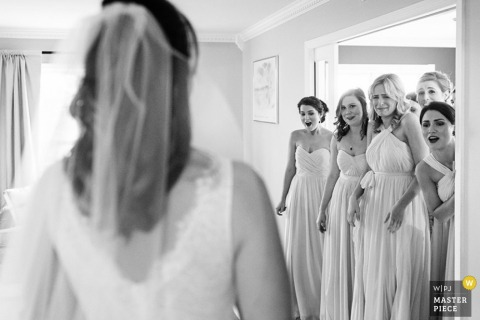 Saratoga Springs bridesmaid react to the bride in her dress - New York wedding photography