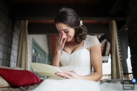 Saratoga Springs bride reads a letter from her groom before the wedding - New York wedding photojournalism