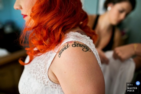 Detail photo of the bride's shoulder tattoo by a Los Angeles, CA wedding photographer.