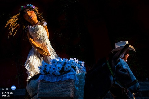 Photo of the bride as a scarecrow by a San Diego, CA wedding photographer.