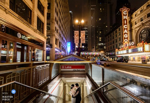 Photo of the bride and groom holding each other on the steps of a subway entrance by a Taipei, Taiwan wedding photographer.