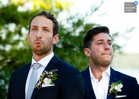 Photo of the groom and best man standing at the altar in anticipation by a Toronto, Ontario wedding photographer.