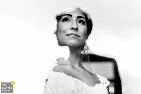 Black and white portrait of the bride partially shrouded by light by an Ottawa wedding photographer.
