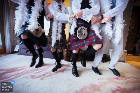 Detail photo of men in kilts dancing by a Hong Kong wedding photographer.