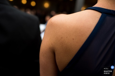 Detail photo of a woman's bare shoulder by an Omaha, NE wedding photographer.